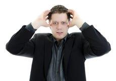 Homem de negócio que olha comprimido do trabalho. Imagem de Stock