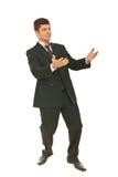Homem de negócio que tenta travar algo Imagens de Stock Royalty Free