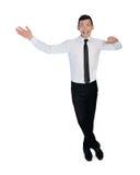 Homem de negócio surpreendido apresentando algo Fotografia de Stock