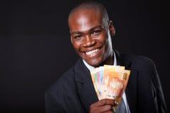 Homem de negócios africano com dinheiro Fotos de Stock Royalty Free