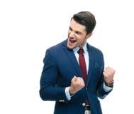 Homem de negócios alegre que comemora seu sucesso Fotografia de Stock