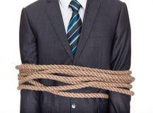 Homem de negócios amarrado acima na corda Fotografia de Stock