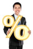 Homem de negócios atrativo que guarda o sinal de por cento Foto de Stock Royalty Free