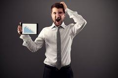 Homem de negócios chocado com relatório Fotografia de Stock