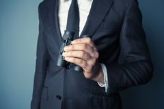 Homem de negócios com binóculos Imagem de Stock