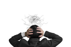 Homem de negócios com cabeça da posse de 2 mãos com expressão e di do desgosto Imagem de Stock Royalty Free