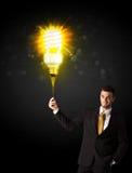 Homem de negócios com um bulbo eco-amigável Fotos de Stock Royalty Free
