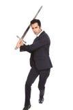 Homem de negócios com uma espada Fotografia de Stock Royalty Free
