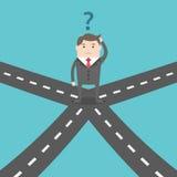 Homem de negócios confuso em estradas transversaas Foto de Stock Royalty Free