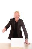 Homem de negócios de sorriso bem sucedido Fotografia de Stock Royalty Free