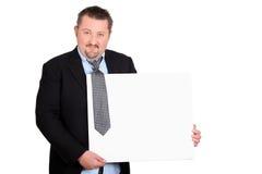 Homem de negócios desalinhado com uma placa Fotografia de Stock