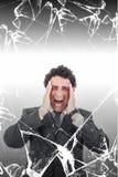 Homem de negócios incomodado com dor de cabeça que grita na dor atrás do brok Imagens de Stock Royalty Free