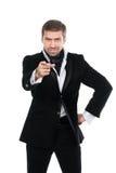 Homem de negócios à moda novo que aponta o dedo no visor Imagem de Stock