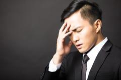 Homem de negócios na depressão com fundo preto Fotos de Stock Royalty Free