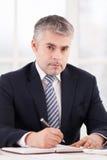 Homem de negócios no trabalho. Imagem de Stock