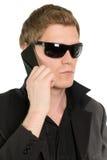 Homem de negócios novo com um telefone Imagem de Stock Royalty Free