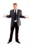 Homem de negócios novo confuso Foto de Stock Royalty Free