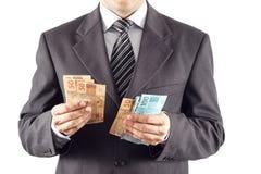 Homem de negócios que conta o dinheiro Fotos de Stock Royalty Free