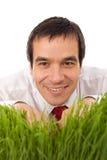 Homem de negócios que esconde na grama - isolada Foto de Stock Royalty Free