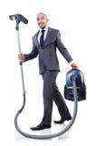 Homem de negócios que faz a limpeza do vácuo Fotografia de Stock