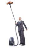 Homem de negócios que faz a limpeza do vácuo Imagem de Stock Royalty Free