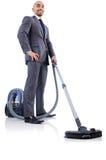 Homem de negócios que faz a limpeza do vácuo Imagens de Stock