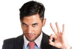 Homem de negócios que faz o sinal aprovado Fotografia de Stock Royalty Free