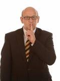 Homem de negócios que gesticula o silêncio Fotos de Stock Royalty Free