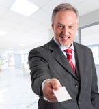 Homem de negócios que introduz-se Fotos de Stock