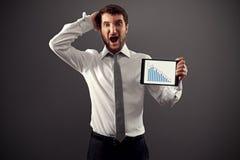 Homem de negócios que mostra o gráfico Imagens de Stock
