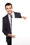 Homem de negócios que prende o poster em branco Fotografia de Stock Royalty Free
