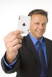 Homem de negócios que prende o ás de clubes Fotos de Stock Royalty Free