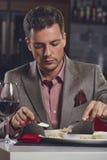 Homem de negócios que tem o jantar Fotografia de Stock