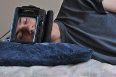 Homem de sono da tevê Imagem de Stock