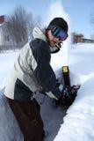 Homem de sopro da neve imagens de stock royalty free