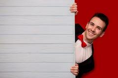 Homem de sorriso novo com placa vazia azul Imagem de Stock Royalty Free