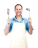 Homem de sorriso que cozinha no avental isolado no fundo branco Foto de Stock