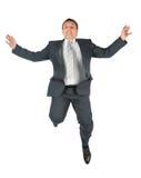 Homem de vôo no terno Imagens de Stock