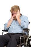 Homem deficiente deprimido na cadeira de rodas Fotos de Stock
