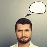 Homem desagradado com bolha do discurso do desenho imagem de stock