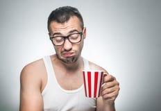 Homem desagradado com café do copo imagens de stock
