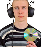 Homem disappointed triste com auscultadores e CD grandes fotografia de stock