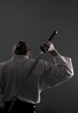 Homem do Aikido com katana (espada) da parte traseira Fotos de Stock Royalty Free