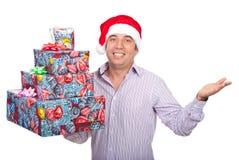 Homem do ajudante de Santa com pedir dos presentes Fotografia de Stock