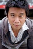 Homem do Asian de Interestng foto de stock
