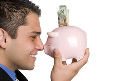 Homem do banco Piggy foto de stock royalty free