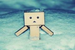 Homem do cartão no tempo da estação do inverno da neve Fotografia de Stock Royalty Free