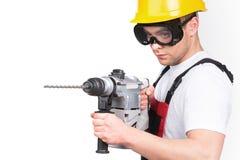Homem do coordenador de construção da construção ou do trabalhador manual no capacete do capacete de segurança da segurança Imagens de Stock