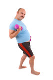 Homem do excesso de peso que faz exercícios Fotografia de Stock Royalty Free