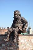 Homem do ferro que senta-se no telhado Foto de Stock Royalty Free